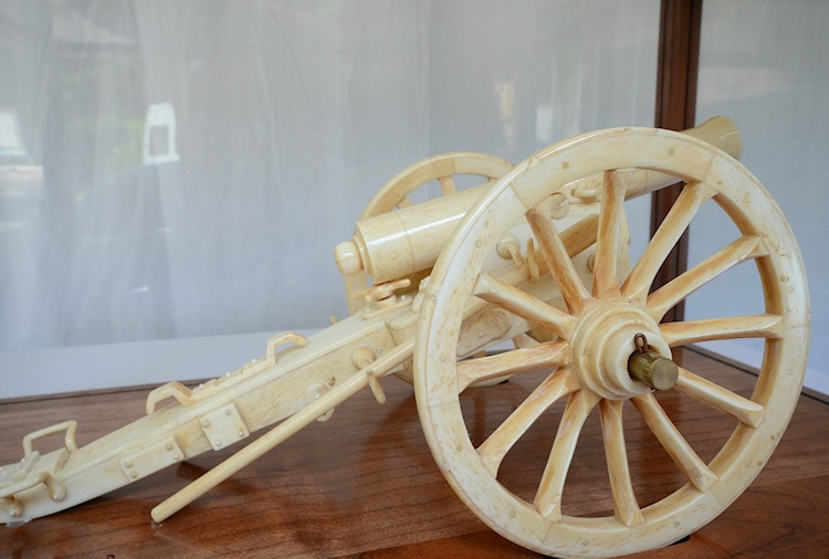 Cannon In Glass Case